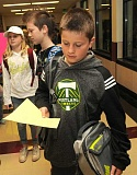TIDINGS PHOTO: VERN UYETAKE - Sixth-grader Eli Tait checks out his class schedule before his first day of middle school at Rosemont Ridge.