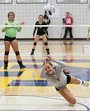 LON AUSTIN/CENTRAL OREGONIAN - Crook County High School setter Abby Smith dives for a ball during the Cowgirls' win over the Estacada Rangers on Tuesday night. Crook County swept the match in straight sets as the Cowgirls remained undefeated and held onto their No. 1 ranking.
