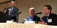 TRIBUNE PHOTO: PETER WONG - Democratic incumbent U.S. Rep. Kurt Schrader, center, and Republican challenger Colm Willis at a business-sponsored forum Monday, Sept. 19, at the Monarch Hotel in Clackamas. At left is the moderator, Mark Meek, who read written questions from the audience.