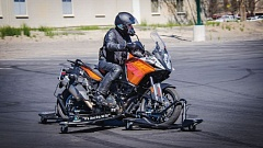 COURTESY SKIDCAR SYSTEM INC. - The Skidbike is a motorcycle fitted with a stability platform similar to a set of training wheels, to allow a rider to experience a loss of control without the risk of injury.  It's being demonstrated at this week's conference.
