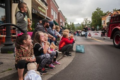 OUTLOOK PHOTO: JOSH KULLA - Children line Main Avenue in downtown Gresham to watch the 2016 Gresham Teddy Bear parade Saturday.