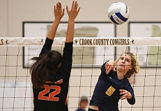 LON AUSTIN/CENTRAL OREGONIAN - Rylee Troutman goes up for one of her seven kills against Gladstone.