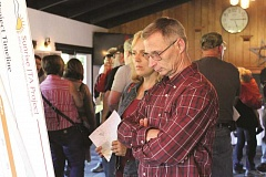 PEGGY SAVAGE - A Molalla-area couple look over a display board showing ODOT's plans for a safety improvement project on Highway 213 at Union Mills Road intersection