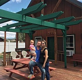 SUBMITTED PHOTO - Sean and Onya Remer with their daughter Emma at the new large cabin which has  four units.