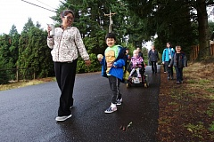 TIMES PHOTO BY JAIME VALDEZ - Lind Mizar walks with her son, Sebastian, to Templeton Elementary School during International Walk and Bike to School Day.