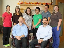HOLLY SCHOLZ/CENTRAL OREGONIAN - The Slater Chiropractic team, front, left to right: Dr. Paul Slater and Dr. Tobias Joyce. Back, left to right: certified assistant Jennifer Bond, office manager Chris Johnston, certified assistant Maureen Boothe, massage therapist Lindsey Rhoden, massage therapist Angela Moon and massage therapist Elizabeth Christensen. Not pictured: certified assistant Robin Fitch and massage therapists Shyla Colovos and Kara George.