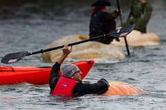 FILE - Kyle Doyle clings to his pumpkin after it flipped over during a race at last year's West Coast Giant Pumpkin Regatta. This year's event has been canceled due to high winds in the forecast, the city of Tualatin announced Thursday.
