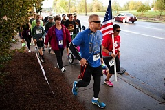 COURTESY PHOTO FROM FREEZE FRAME PHOTOGRAPHY - Community members jog in the 2014 Regatta Run in Tualatin. The annual event honors Cpl. Matt Lembke, a Tualatin High School alumnus who was killed in action while on a tour of duty in Afghanistan seven years ago.