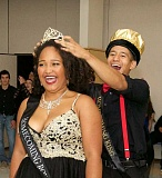 PHOTO BY JUSTIN MCCORMACK - MHS Homecoming King Omas Dominguez crowns Queen Idalis Ibrahim at the homecoming dance.