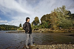 TRIBUNE PHOTO: JAIME VALDEZ - Travis Williams, head of the Willamette Riverkeeper, stands where Johnson Creek flows into the Willamette River in Milwaukie. PCBs in the creek could migrate to the river and then the Portland Harbor Superfund site.