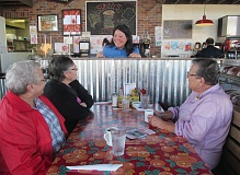 PHOTO BY ELLEN SPITALERI - Sunny Burden, center, co-owner of Sunny's Diner, chats with, from left, Geri Adams and Carolyn Bonagofski, and right, Mol Craven.
