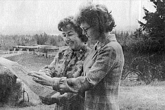 PHOTO COURTESY OF FRIENDS OF TRYON CREEK - Lu Beck (left) and Jean Sidall study a map marking the area they hoped to turn into a state park in 1970. The photo was taken in Beck's backyard on Englewood Drive.