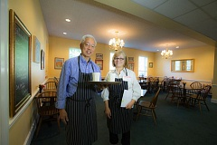 COURTESY ALBERTINA'S PLACE - Dr. Alfred Ono, a retired Ob-Gyn, and Peggy Schlegel, co-kitchen director, regularly volunteer at Albertina's Place, a nonprofit serving the Albertina Kerr organization.