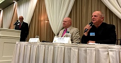 TRIBUNE PHOTO: PETER WONG - Challenger Jim Bernard, right, fields a question as Chairman John Ludlow listens at a forum Thursday, Oct. 20, in Oregon City. Moderator Ernie Platt is at left.