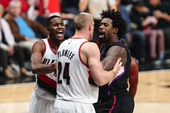 TRIBUNE PHOTO: DAVID BLAIR - DeAndre Jordan (right) of the Los Angeles Clippers and center counterpart Mason Plumlee of the Trail Blazers mix it up during Thursday night's game at Moda Center.