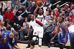 TRIBUNE PHOTO: JAIME VALDEZ - Trail Blazers guard Damian Lillard finds space between Golden State defenders for a jump shot Tuesday night at Moda Center.