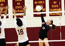 DAN BROOD  - Sherwood junior Emily Bacewich (12) goes up for a kill during Saturday's match at Central Catholic.