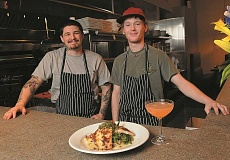 TIDINGS PHOTOS: VERN UYETAKE - Sous chefs Benjamin Calvillo, left, and Robert Carlile show off the restaurants parmasean crusted petrale sole.