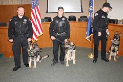 REVIEW PHOTO: ANTHONY MACUK - From left: Officer Vaughn Bechtol and Charger, Officer Bryan McMahon and Chase, and Officer Brendon Clausen and Szemi.
