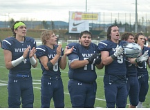 SPOKESMAN FILE PHOTO: COREY BUCHANAN - Wilsonville football players (left to right) Connor Neville, Brandon Matthews, Eric Moya and Dominic Enbody clap while facing the crowd after the team's semifinals win over Central.