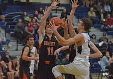 HERALD PHOTO: COREY BUCHANAN - Canby senior wing Dylan Taylor dropped a game-high 21 points against the Foxes.