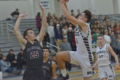 SPOKESMAN PHOTO: COREY BUCHANAN - Wilsonville wing Harrison Steiger rises up for a ferocious and-one dunk in the first quarter against Franklin.