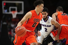 TRIBUNE PHOTO: RANDY RASMUSSEN - Portland Pilots point guard Alec Wintering (2) fights through a screen as he guards JaQuori McLaughlin of Oregon State.