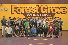 NEWS-TIMES PHOTO: CHASE ALLGOOD - The Forest Grove High School wrestling team wears maroon and gold mouth guards -- the Vikings' school colors -- created by Tidwell Dental in Forest Grove.