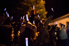 PHOTO BY ADAM WICKHAM - Supporters hold up glow sticks at Monday nights vigil for wounded State Trooper Nic Cederberg, who was shot on Christmas night during a homicide investigation in Sherwood.
