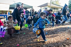 OUTLOOK PHOTO: JOSH KULLA - Kids three and under dash for Easter eggs Saturday morning at West Gresham Elementary School, as the City of Gresham hosted its annual egg hunt. Gresham Fire Department personnel have been staffing this even for more than a half century.