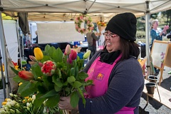 OUTLOOK PHOTO: JOSH KULLA - Nicole Lo of Royal Gardens prepares a bouquet of tulips or a customer Saturday on opening day of the 2017 season for the Gresham Saturday Market.