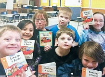 CONTRIBUTED PHOTO - Connie Redmond enjoys reading with students at River Mill Elementary each week.