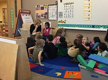 SPOKESMAN PHOTO: ANDREW KILSTROM - Boones Ferry preschool teacher Cathy Scoggins reads a book to her class Thursday, March 23.