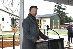 COURTESY GUARDIAN REAL ESTATE SERVICES - Tom Brenneke, who spoke at the opening of the NAYA affordable housing project that his company built, recently quit a city housing advisory panel.