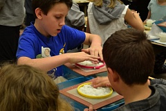 POST PHOTO: BRITTANY ALLEN - Students intently spread their pulp into  plastic deckles to create circular pieces of paper.