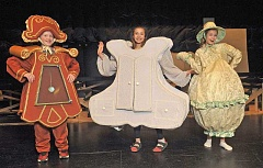 STAFF PHOTO: VERN UYETAKE - From left, West Linn-Wilsonville middle school students Chance Kirk as Cogsworth, Nathalia Nicolade as The Wardrobe and Peyton Henry as Mrs. Potts star in 'Beauty and the Beast.'