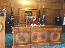 PARIS ACHEN/CAPITAL BUREAU - Gov. Kate Brown in her ceremonial office in Salem signs an executive order Feb. 2, 2017, prohibiting state employees from using time or resources to help the federal government enforce immigration law.