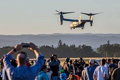 HILLSBORO TRIBUNE PHOTO: CHASE ALLGOOD - The audience snaps pictures of the US Marine Corps MV-22 Osprey as it hovers over the Hillsboro Airport during the 2016 Oregon International Air Show.
