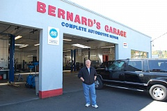 PHOTO BY: RAYMOND RENDLEMAN - Clackamas County Chairman Jim Bernard stands in front of the auto-repair business that his family has owned for 92 years.