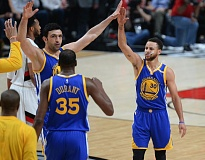 TRIBUNE PHOTO: JOSH KULLA - It was a high-five night all the way around for the Warriors on Monday, and especially for hot-shooting guard Stephen Curry Iright).