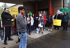 TIMES PHOTO: JAIME VALDEZ - Christian Calzada, a student at Portland Community College, addresses advocates for Tigard to declare itself a sanctuary city outside Tigard City Hall before Tuesday's council meeting.