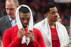 TRIBUNE PHOTO: JOSH KULLA - After being routed in Game 4, the Trail Blazers biggest guns of 2016-17, guards Damian Lillard (left) and CJ McCollum, call it a season.