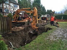 SUBMITTED PHOTO: LAKE OSWEGO ENGINEERING DEPARTMENT - Crews work to stabalize a sinkhole and clear out nearby hazards after heavy rains in December 2015. The City shared this photo with The Review in March 2016, before an Oak Creek homeowner filed a lawsuit over the repairs.