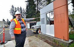 REVIEW PHOTO: VERN UYETAKE - Public Works Director Anthony Hooper demonstrates the test wall that staff and construction crews have been using to test out exterior building designs. The new Maintenance Center will incorporate the design on the left.
