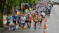 REVIEW FILE PHOTO: VERN UYETAKE - Lake Run participants may start on downtown's relatively flat roads, but the annual event is really known for its hilly terrain and breathtaking views.