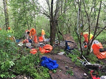 KOIN 6 NEWS - Inmate work crews cleaned up homeless camps at Thousand Acres. (MCSO)