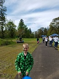 SUBMITTED PHOTO - Second grader Mark Girardy, with his face freshly painted, stands at the front of Gladstone Nature Park with April 29 festivities in the background.