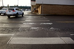 TIMES PHOTO: JAIME VALDEZ - This weathered mid-block crosswalk just north of a Tigard Plaza driveway off Hall Boulevard will soon be replaced with a crossing further up the road that will feature a flashing beacon and median island, according to the Oregon Department of Transportation.