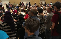 TIMES PHOTO: DANA HAYNES - An estimated 500 people crowded into the Muslim Educational Trust Center in Tigard on Saturday to celebrate the first night of Ramadan, but also to hold a vigil following a fatal attack on a MAX train.