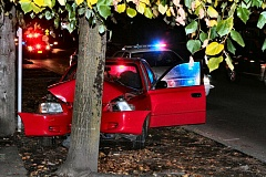 DAVID F. ASHTON - Losing control of his car, the driver of this Hyundai smashed head-on into a tree on Powell Boulevard.